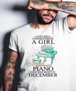 Never underestimate a girl who plays piano and born in December T-